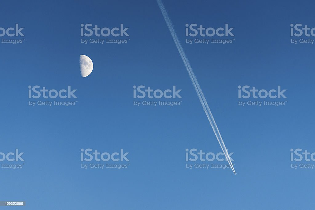 Moon and plane trail royalty-free stock photo