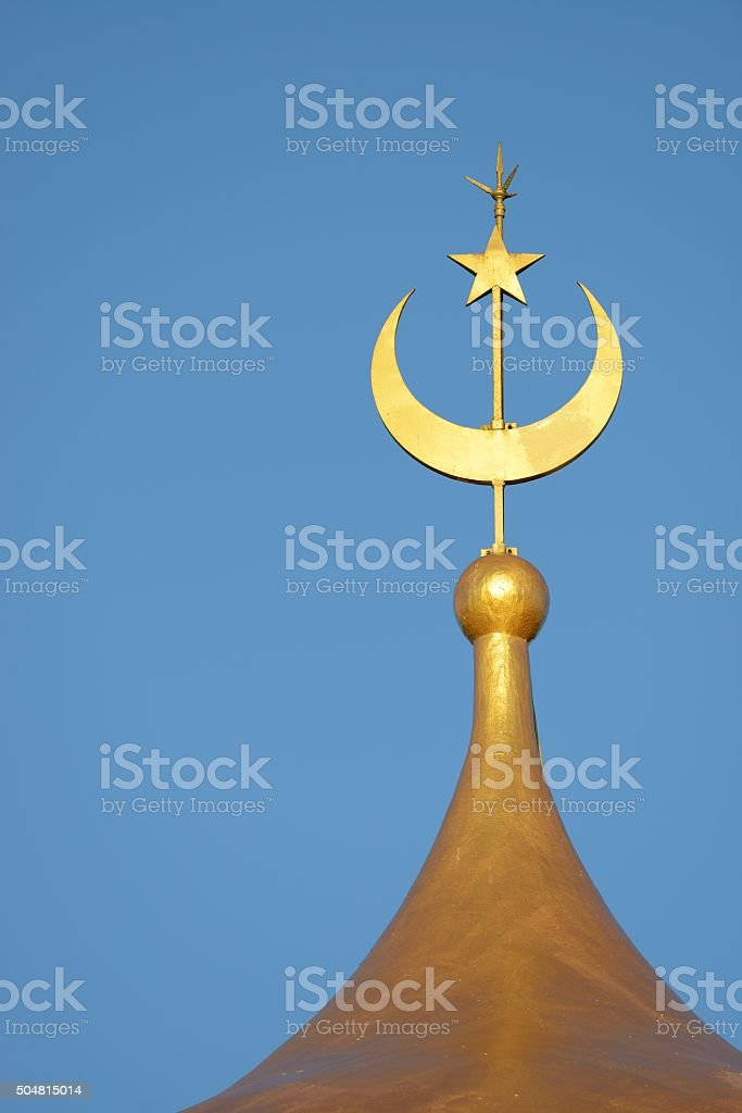 Moon and star of a Mosque with blue sky stock photo