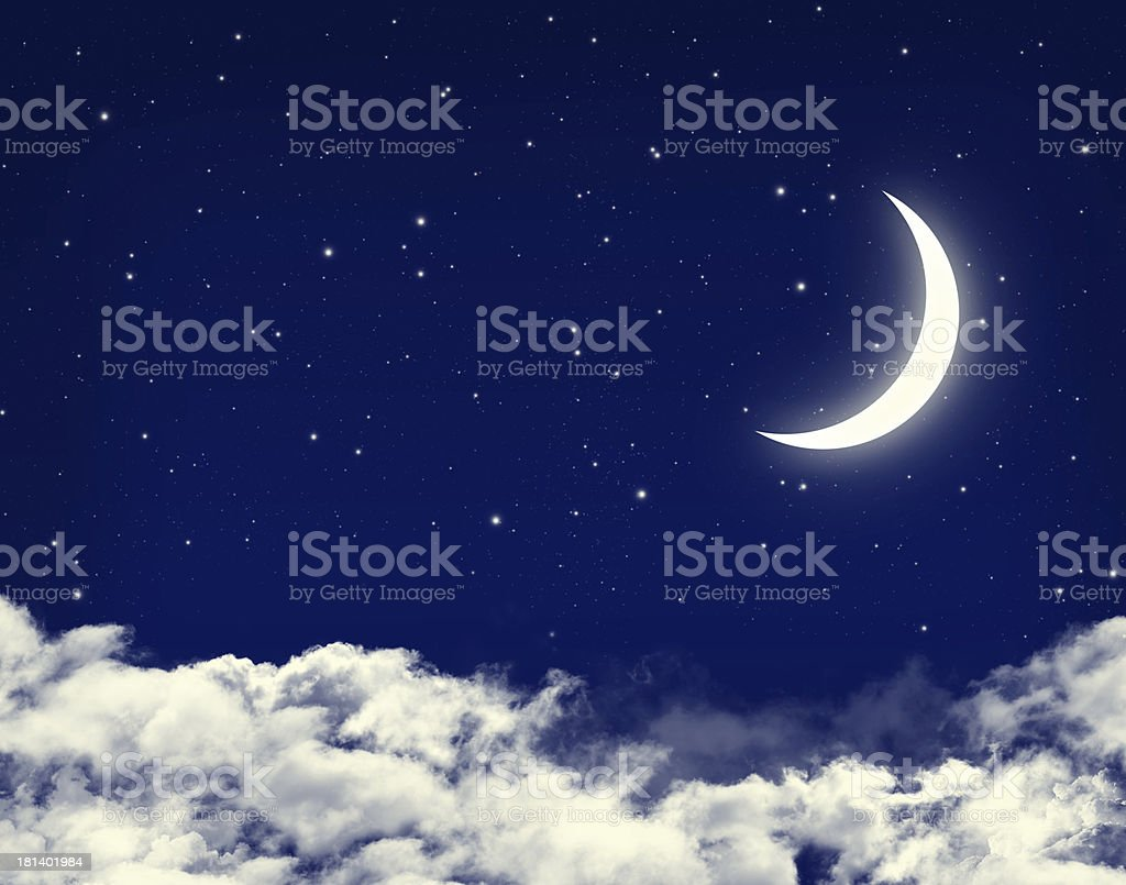 Moon and stars in a cloudy night blue sky royalty-free stock photo