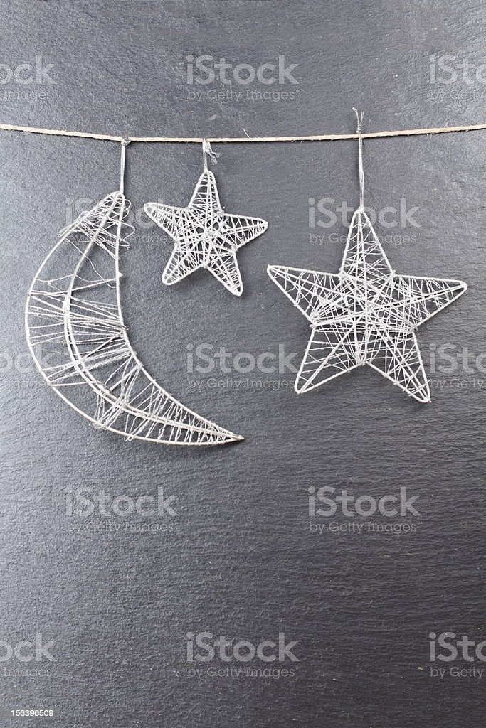 Moon and stars with a slate as background royalty-free stock photo