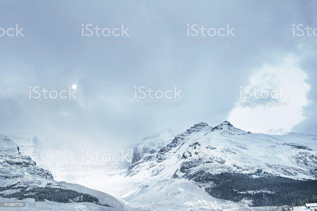 Moon at dawn, Athabasca Glacier, Canadian Rockies stock photo