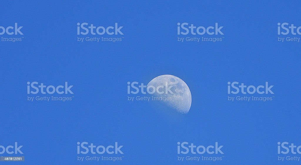 Moon at noon stock photo