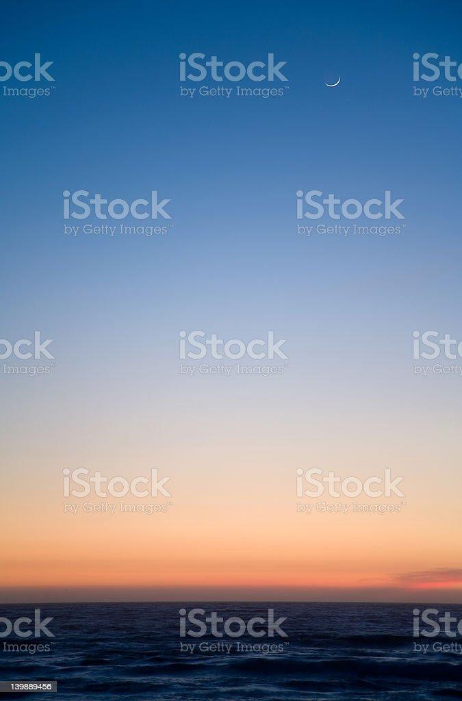 Moon at sunset stock photo