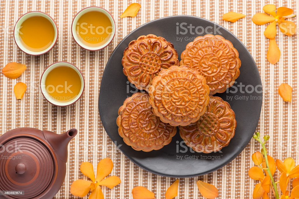 Moon cake with teapot stock photo