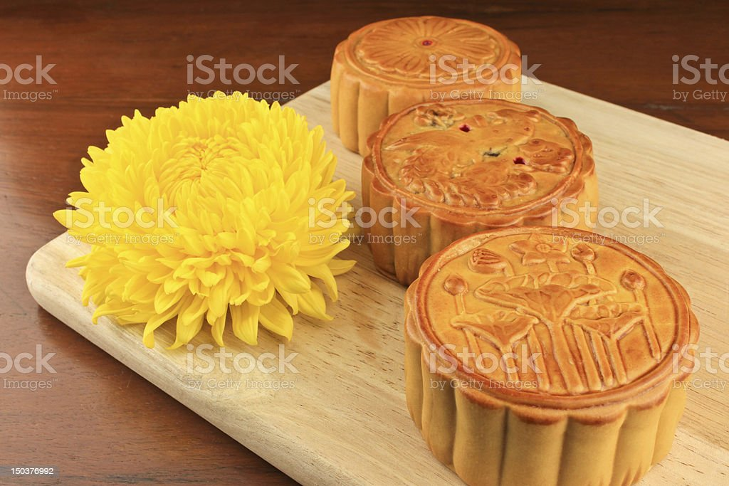 Moon cakes on a wooden tray. stock photo