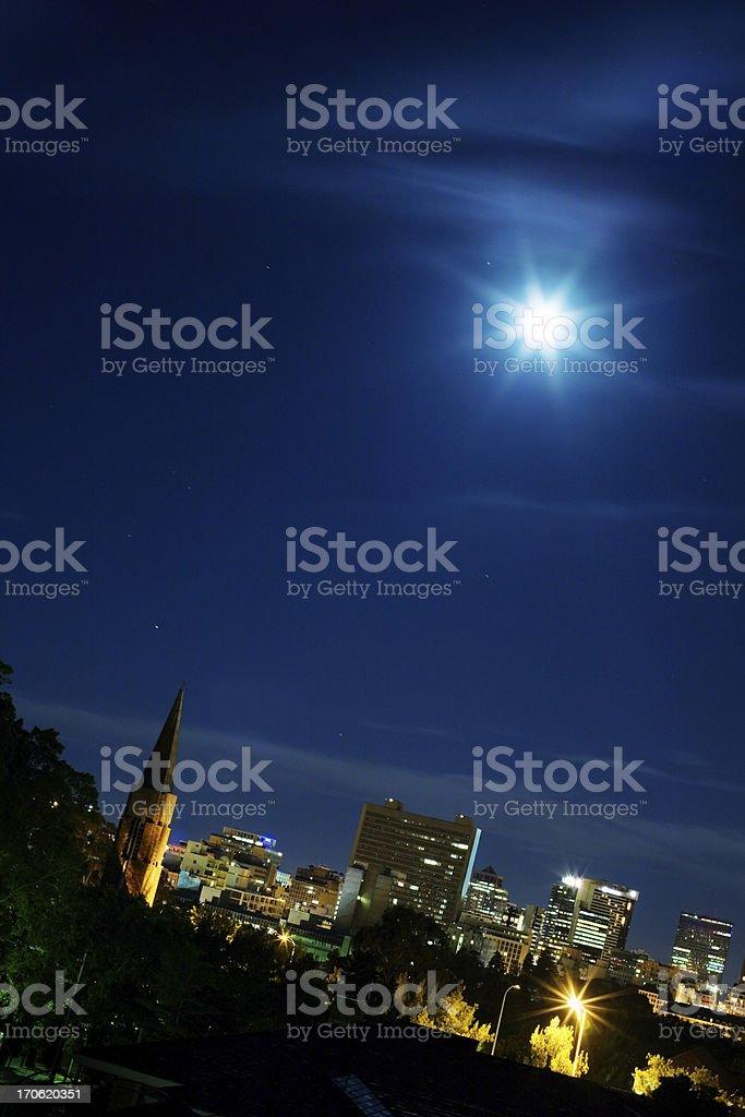 Moon, church, city lights stock photo