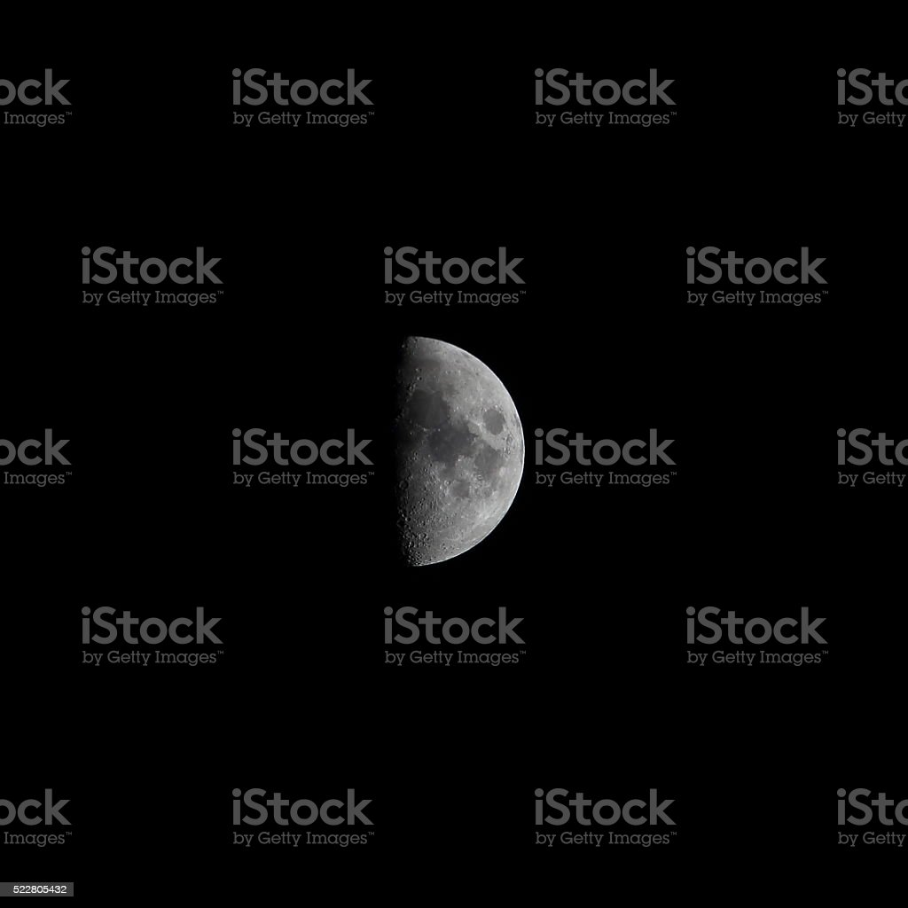 Moon first quarter spring stock photo