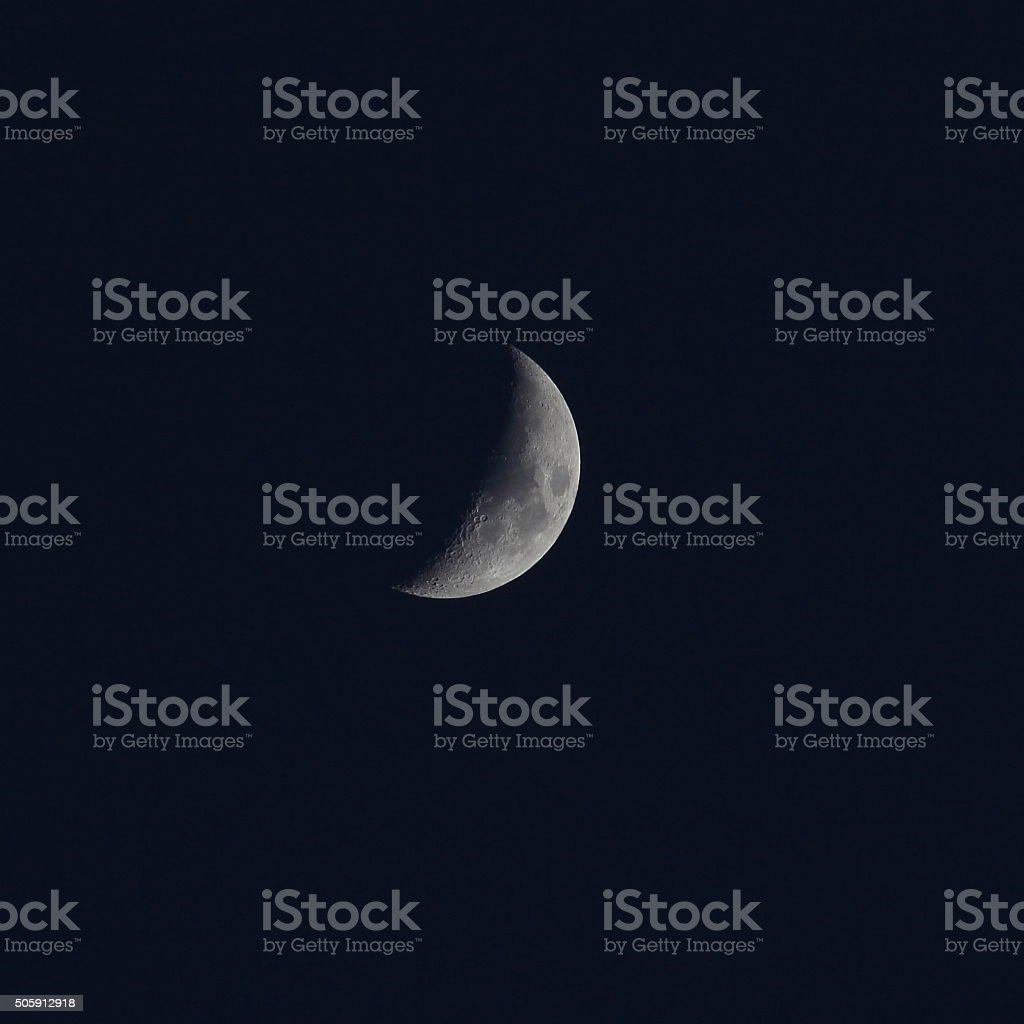 Moon first quarter winter stock photo