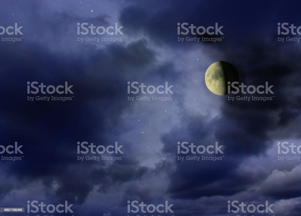 Moon glowing in the dark night sky stock photo