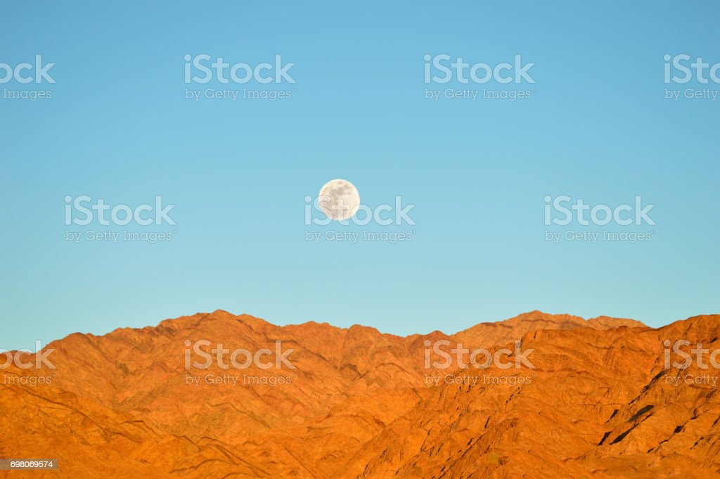 moon in the desert stock photo