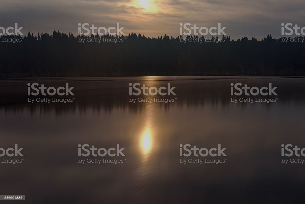 moon lake forest reflection stock photo