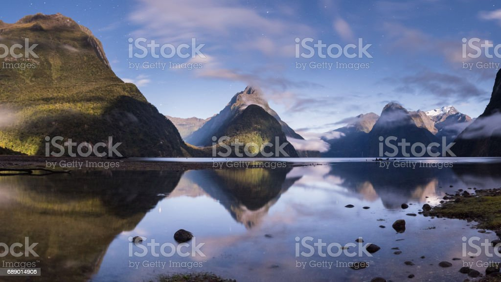 Moon light Milford sound New Zealand stock photo