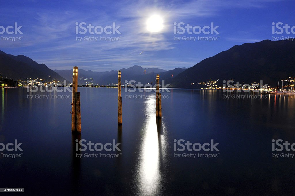 Moon light over an alpine lake stock photo