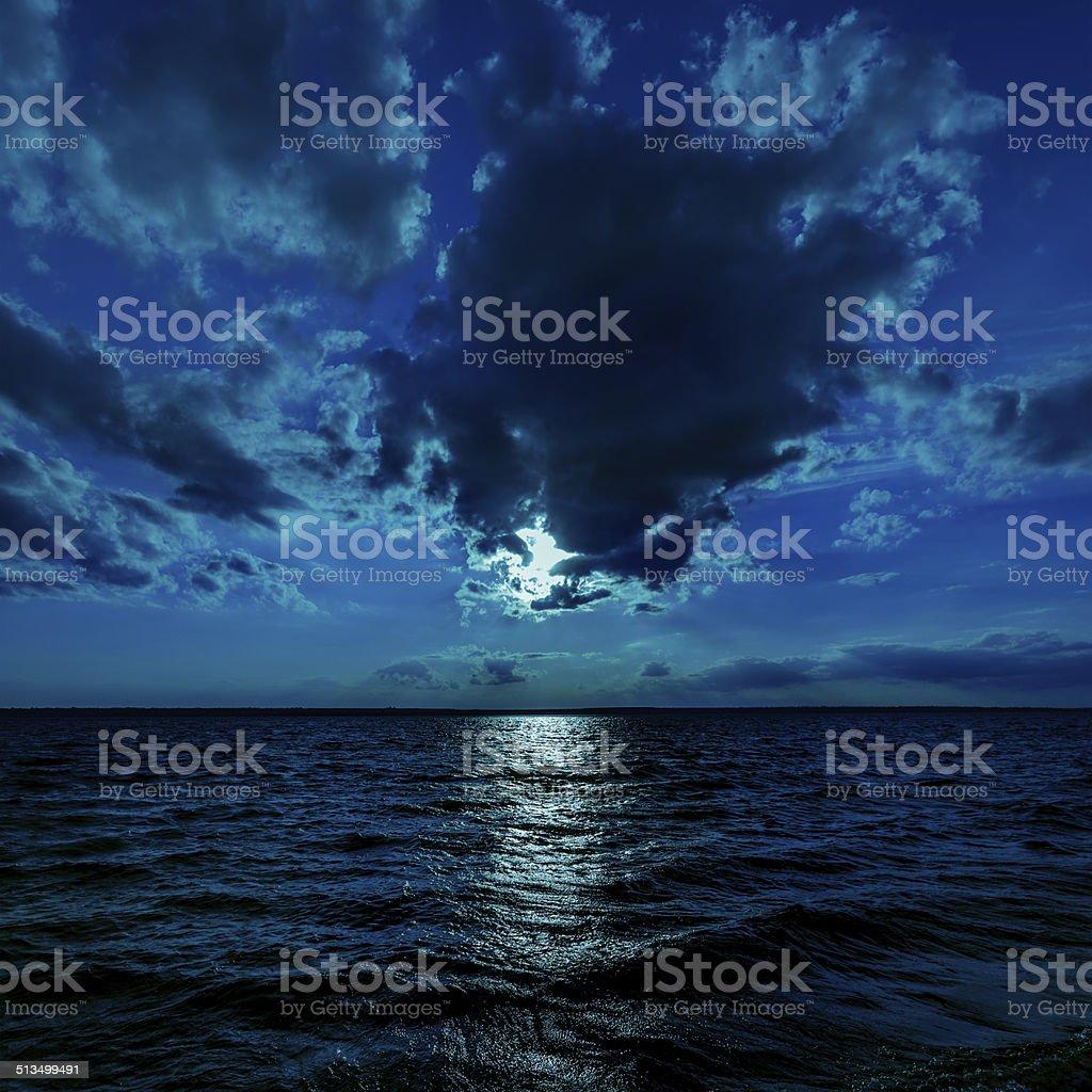 moon light over dark water stock photo