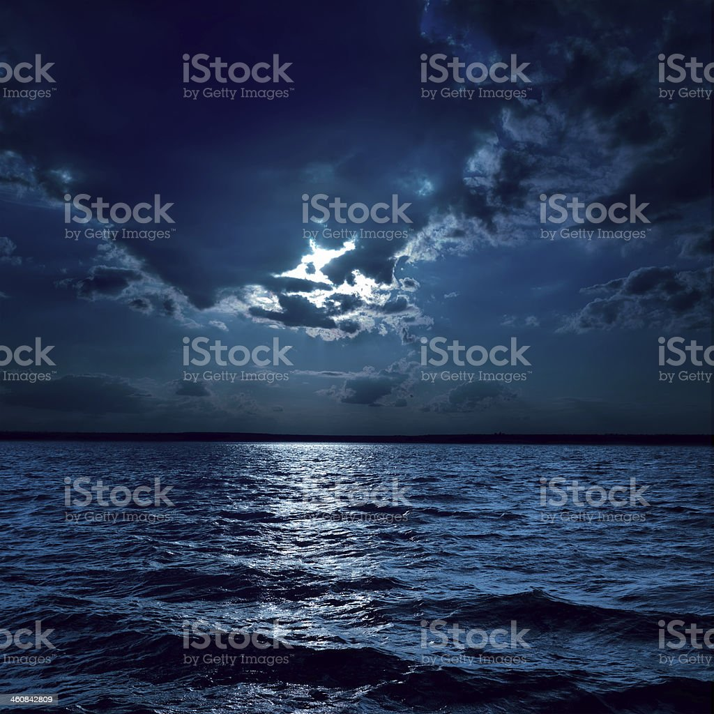 moon light over darken water stock photo