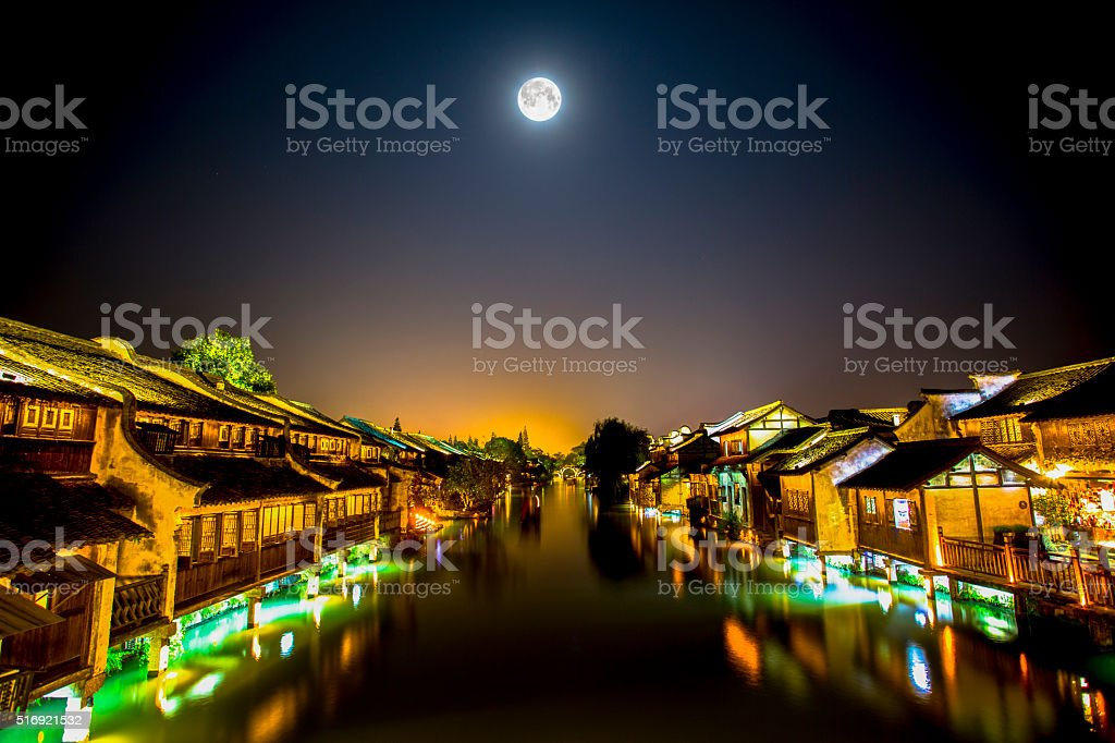 moon night and ancient town stock photo