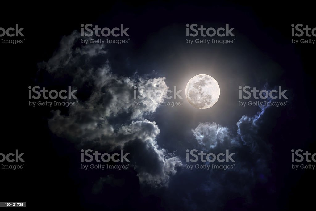 Moon on Cloudy day stock photo