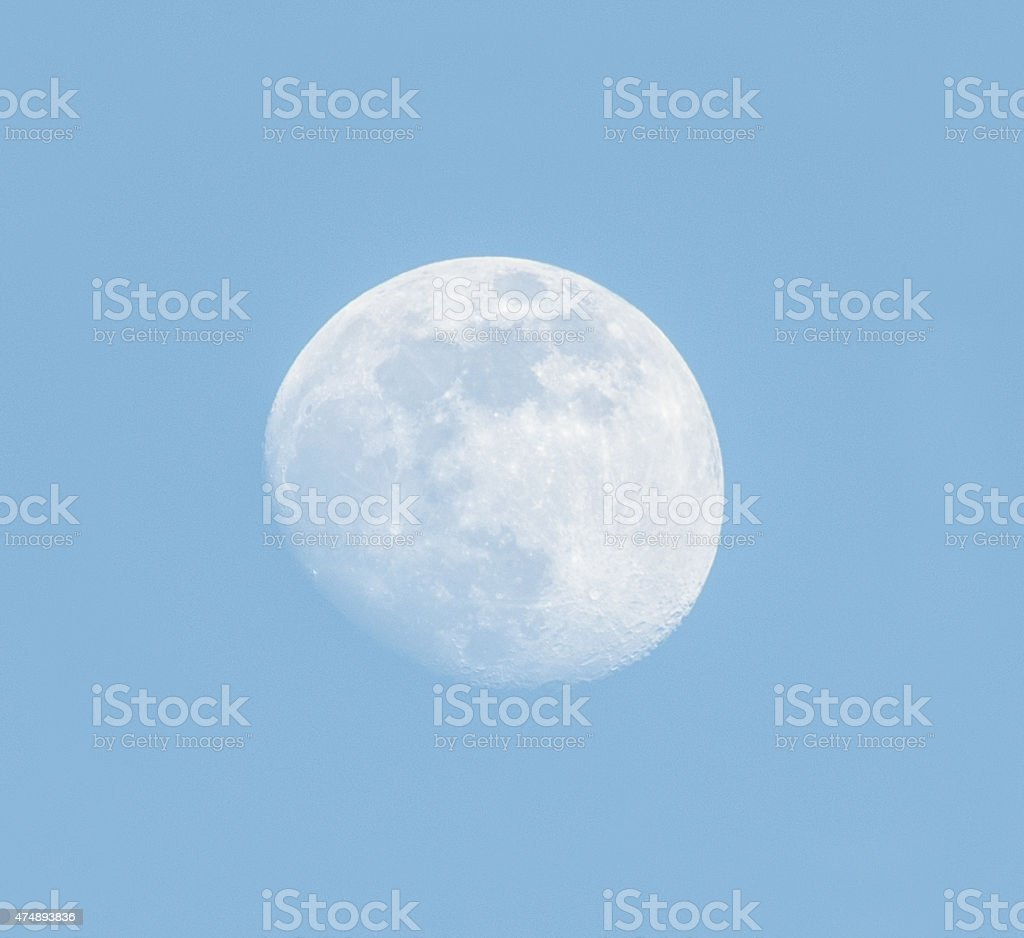 Moon over blue sky stock photo