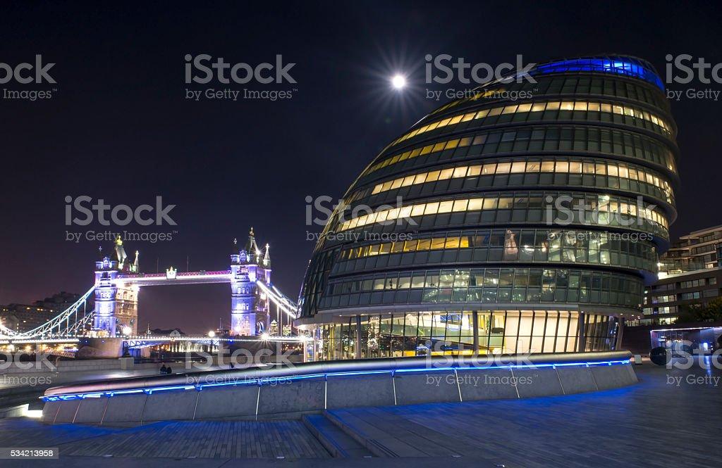 Moon over City Hall and Tower Bridge stock photo