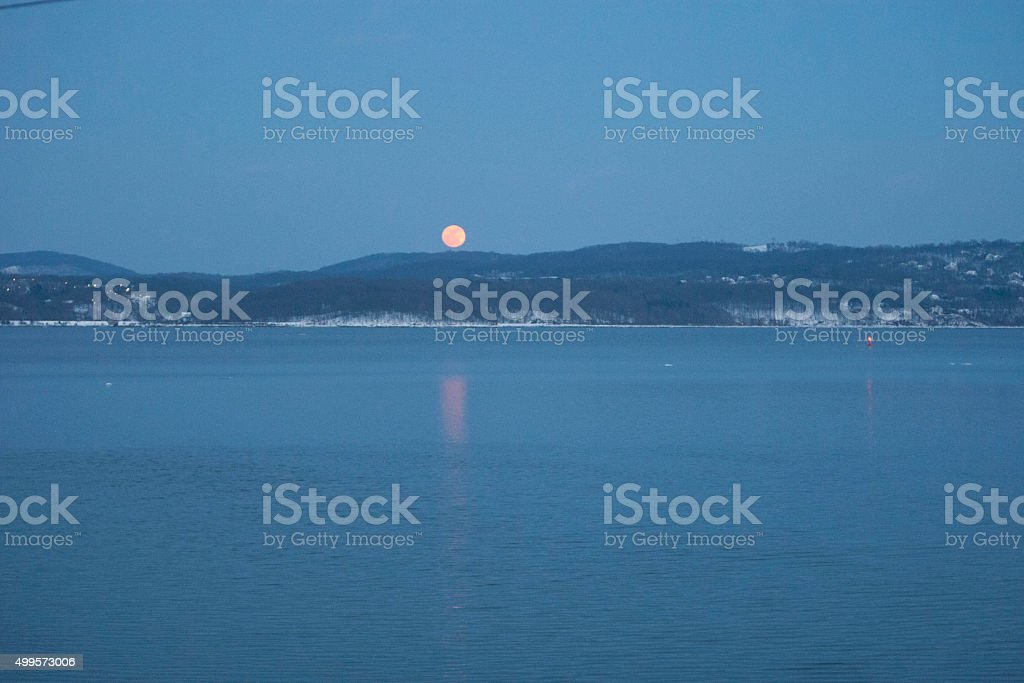 Moon over Hudson River stock photo