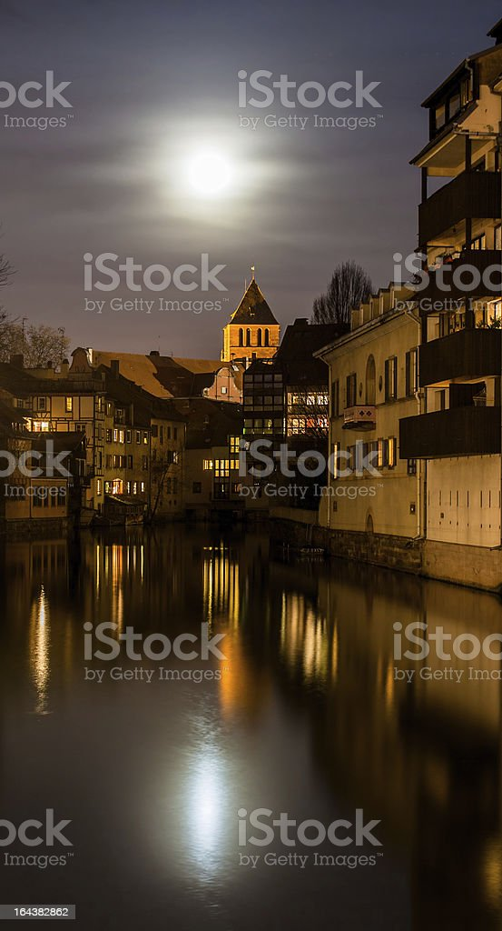 Moon over Ill river in Petite France area, Strasbourg royalty-free stock photo