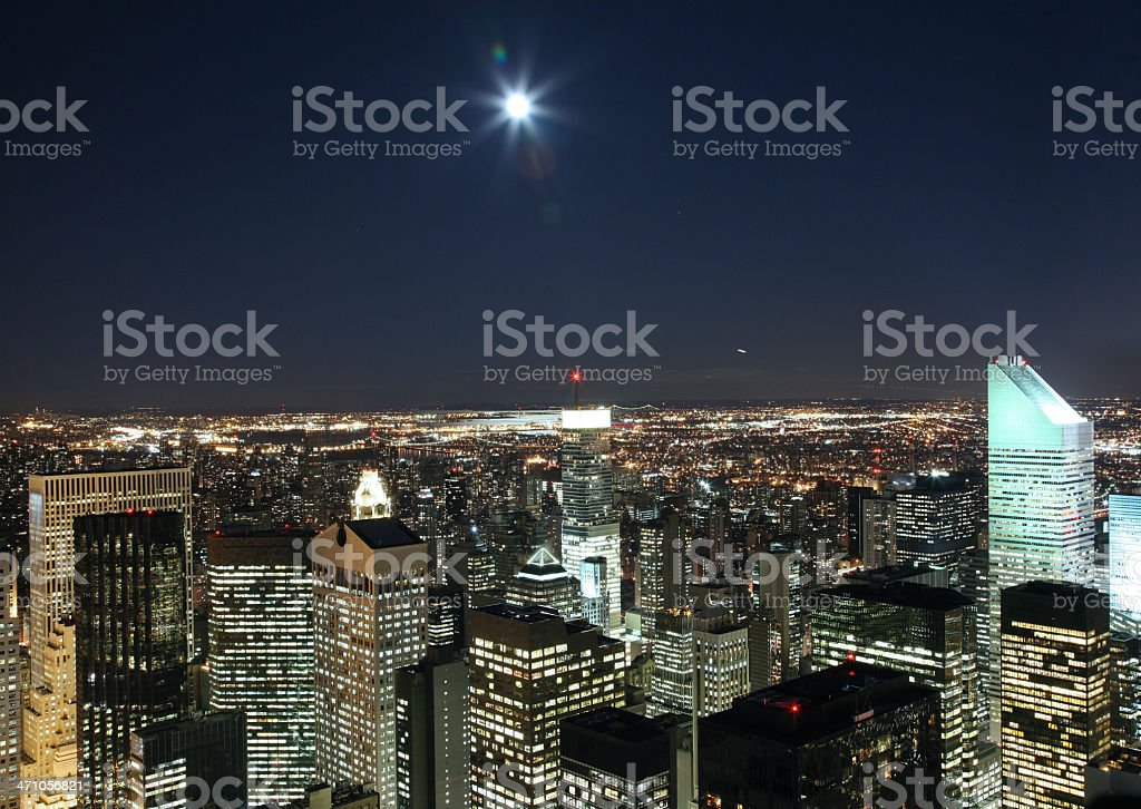 Moon Over Manhattan Skyline, Long Exposure royalty-free stock photo