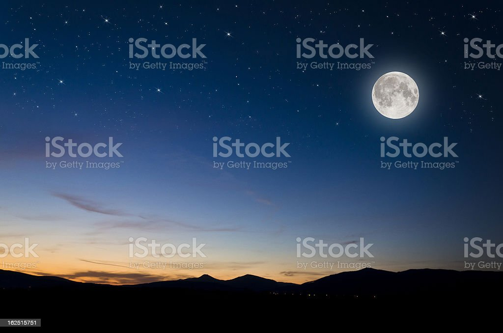 moon over mountains stock photo