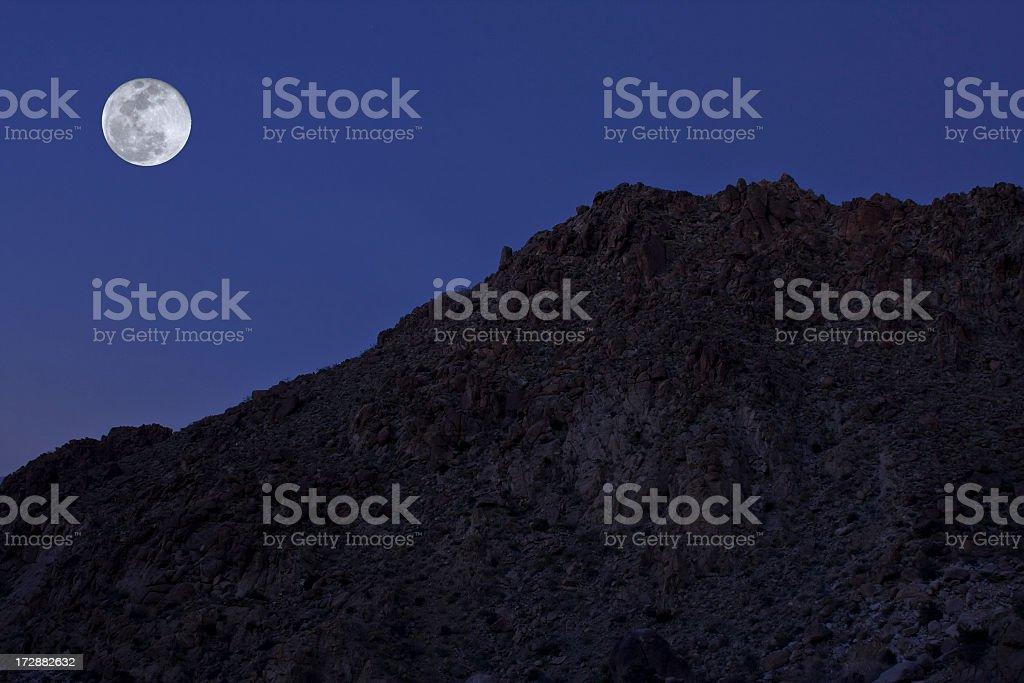 moon over rocky ridge royalty-free stock photo