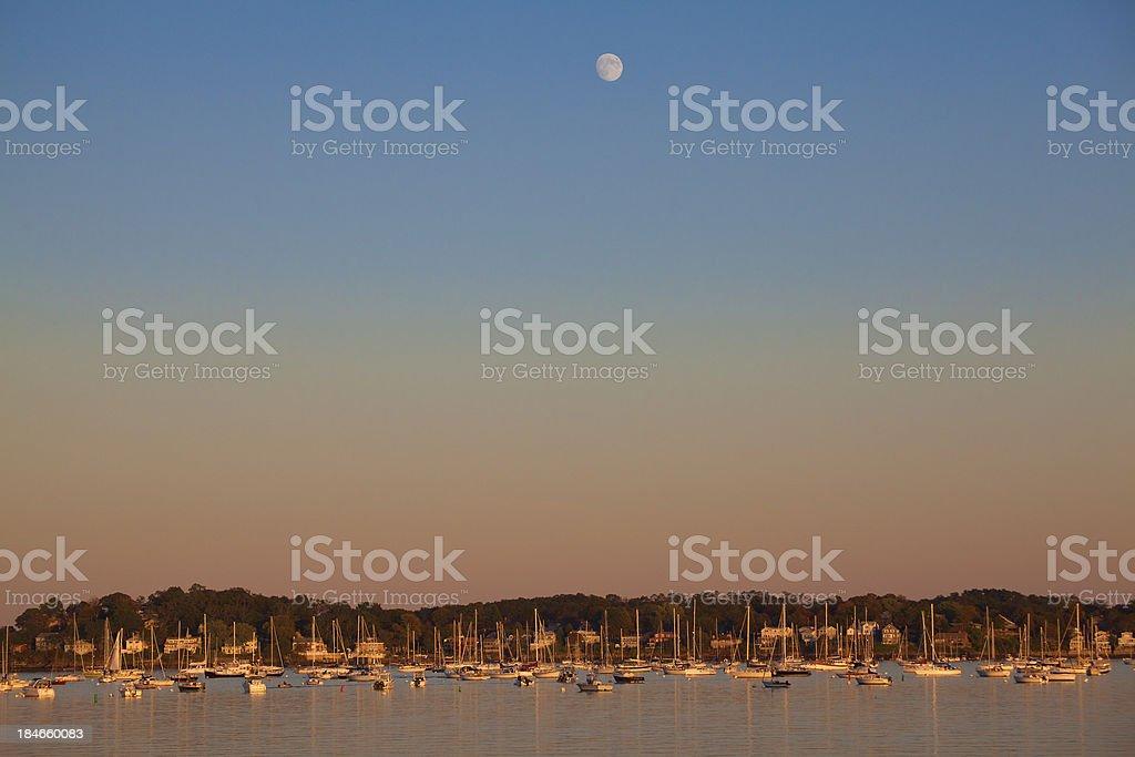 Moon over Salem Harbor stock photo