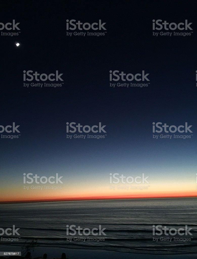 Moon Over Sunset stock photo