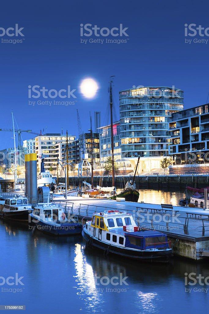 Moon over the illuminated HafenCity stock photo