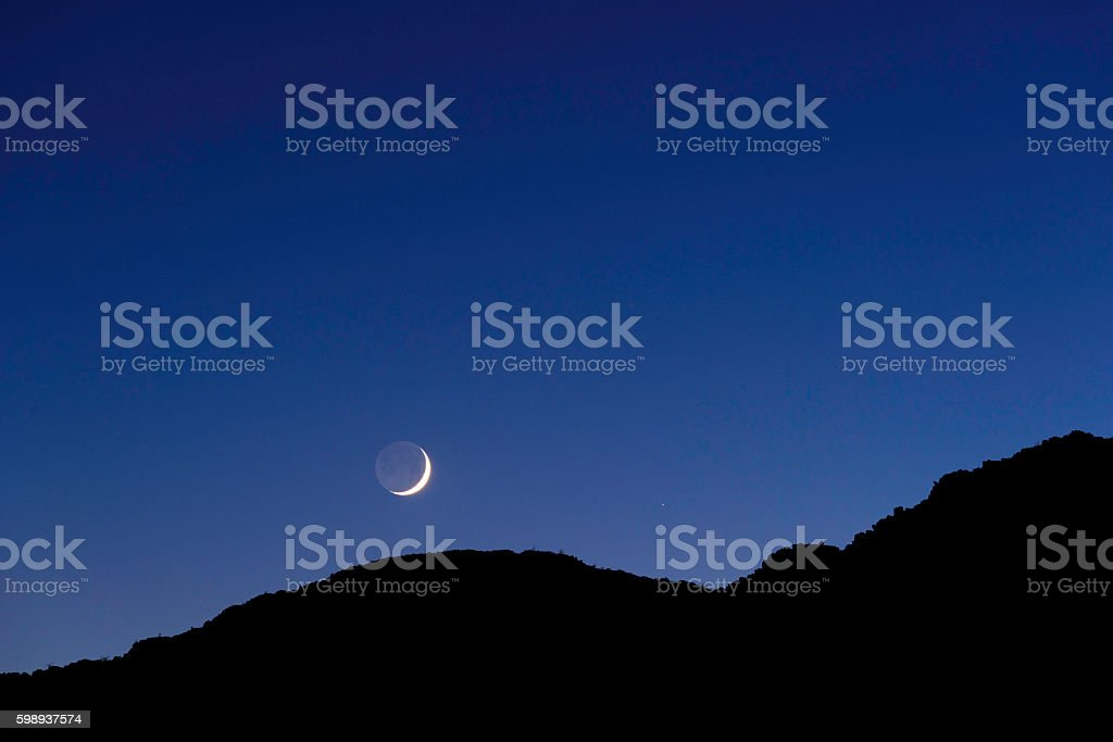 Moon over the mountain stock photo