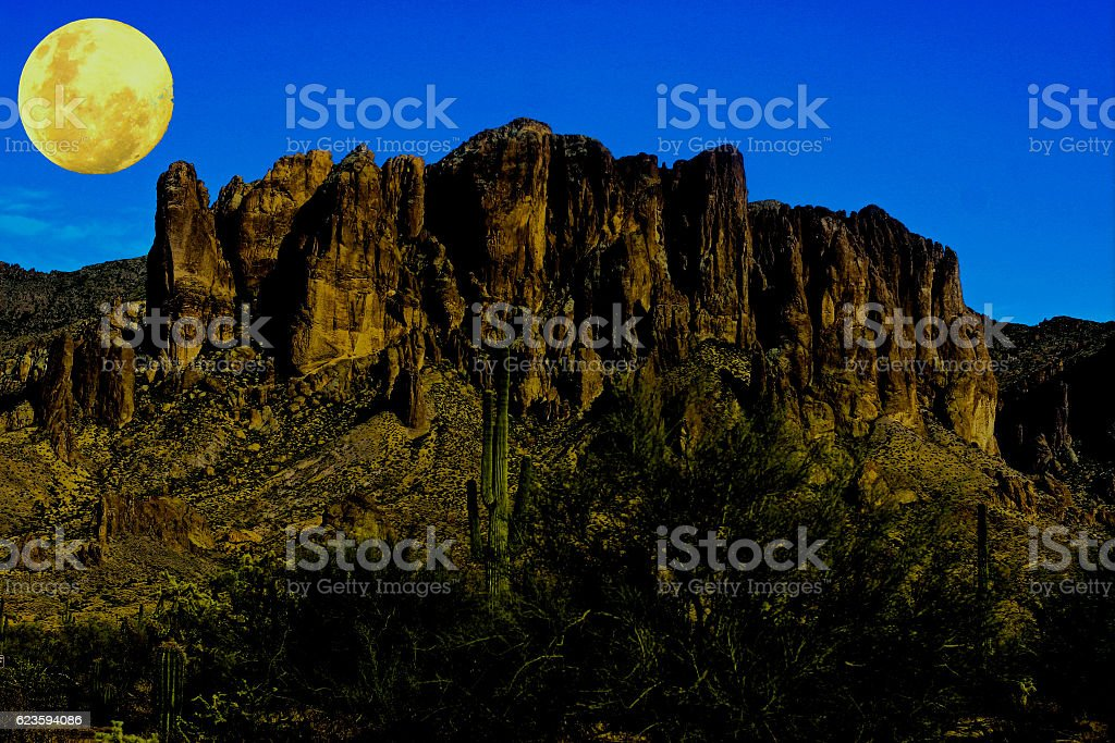 Moon over the superstition mountains stock photo