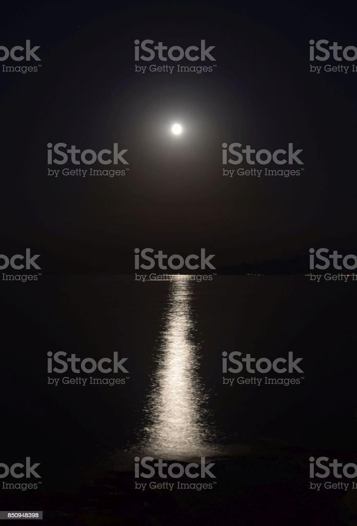 Moon path on the sea. stock photo