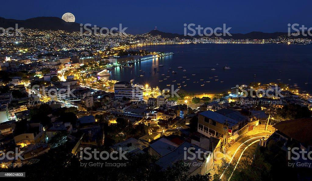 Moon rise over Acapulco Mexico stock photo