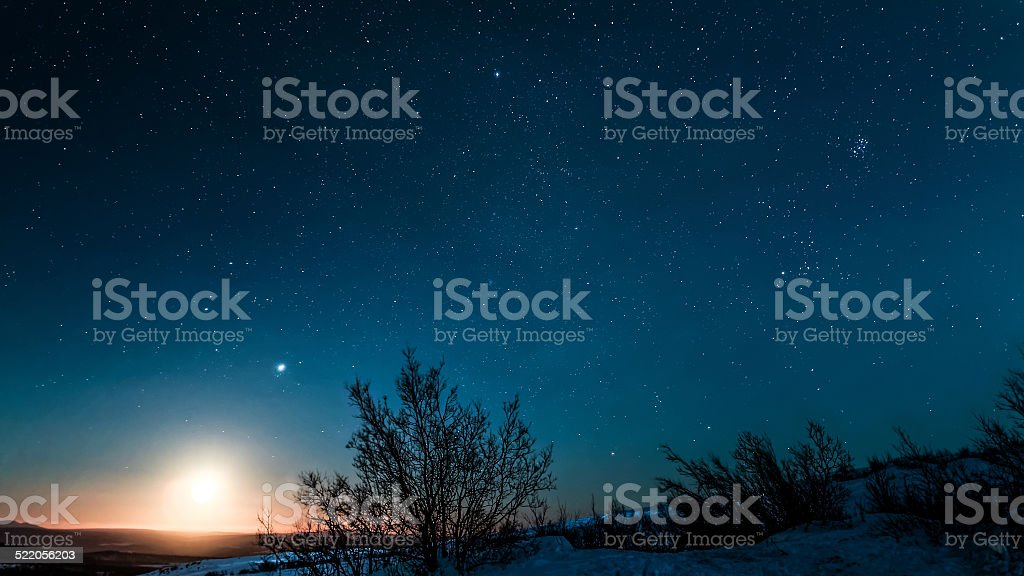 Moon rise over arctic landscape in northern Sweden stock photo
