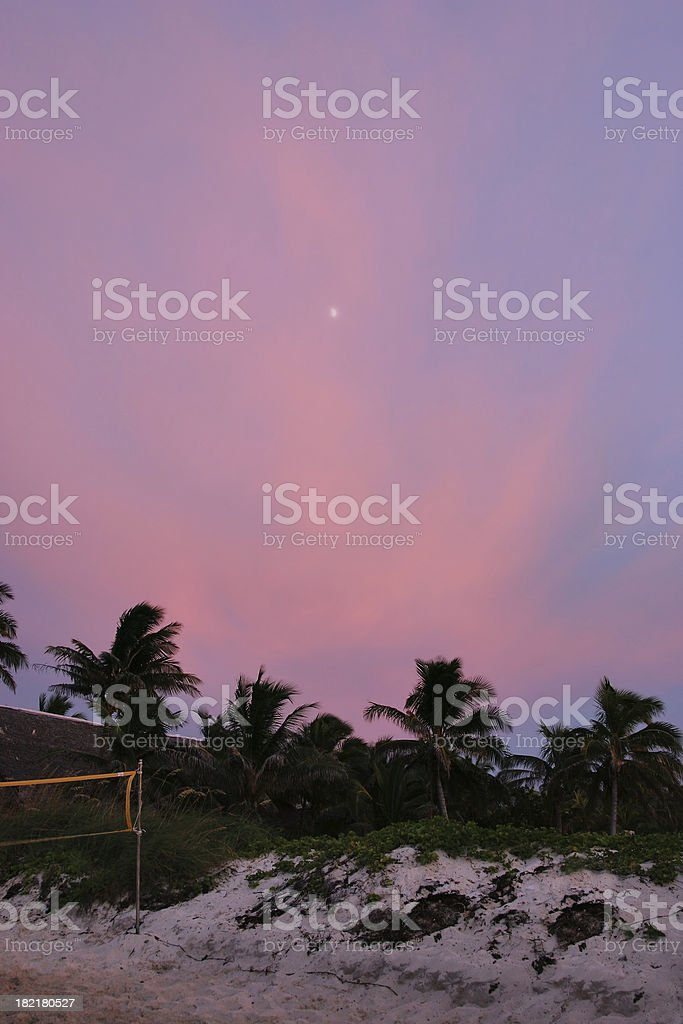 Moon rising in pink sky stock photo