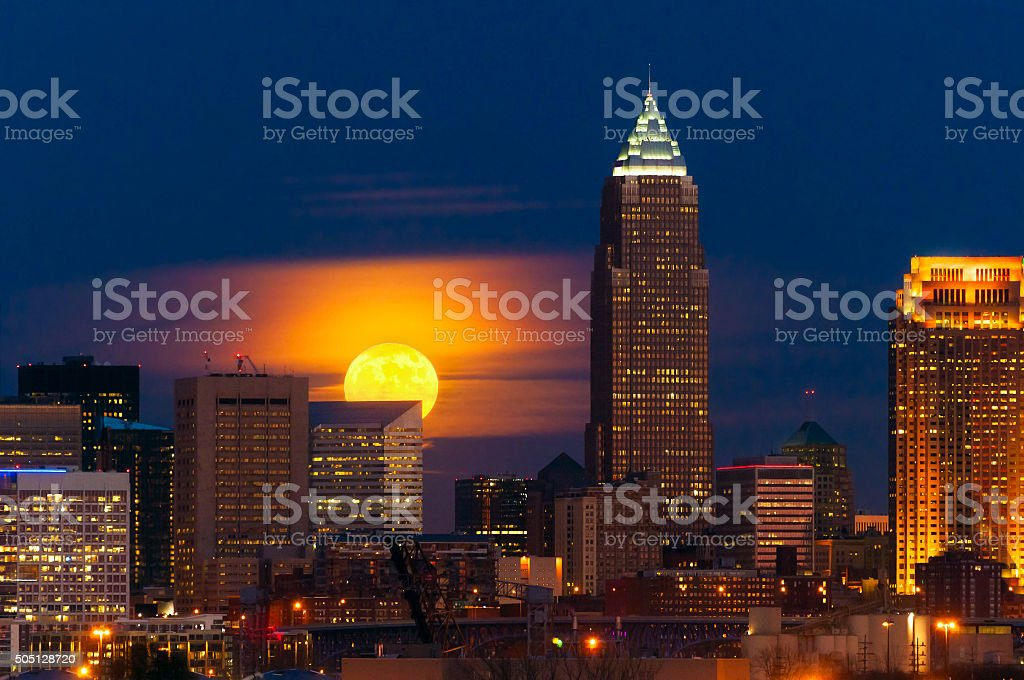 Moon rising over Cleveland stock photo