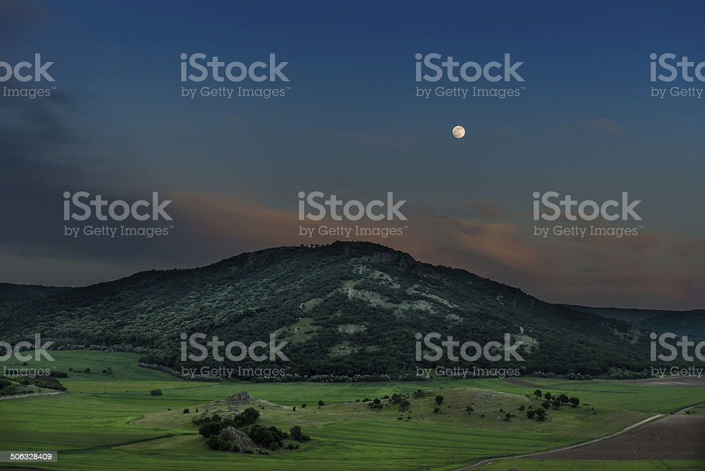 Moon Rising Over Mountains stock photo