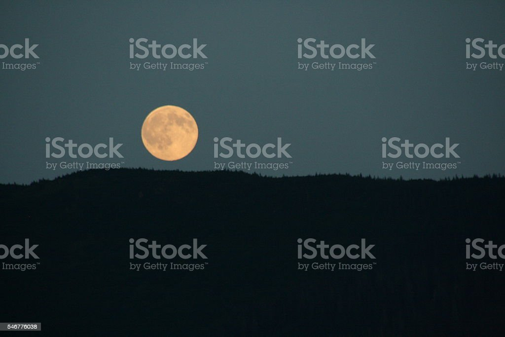 Moon Rising Over Northern Landscape stock photo