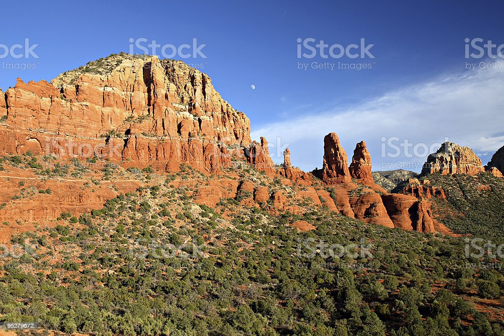 Moon Rising Over Red Sandstone Bluffs in Sedona, Arizona stock photo