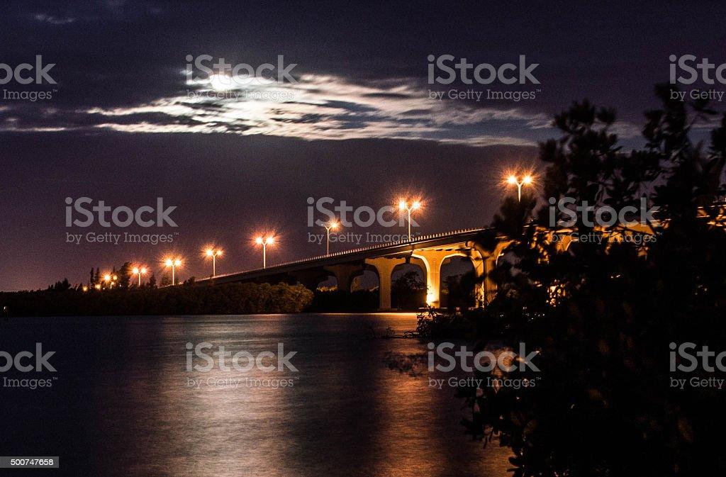 Moon Setting Over River Bridge stock photo