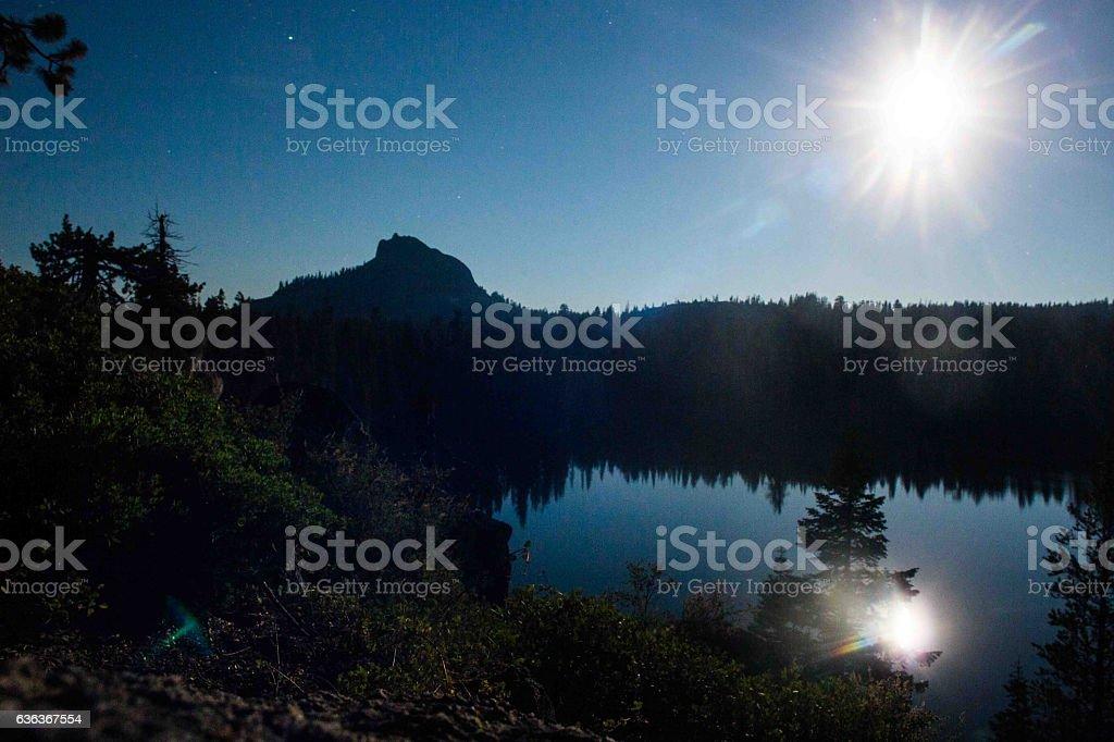 Moon Setting over the lake stock photo