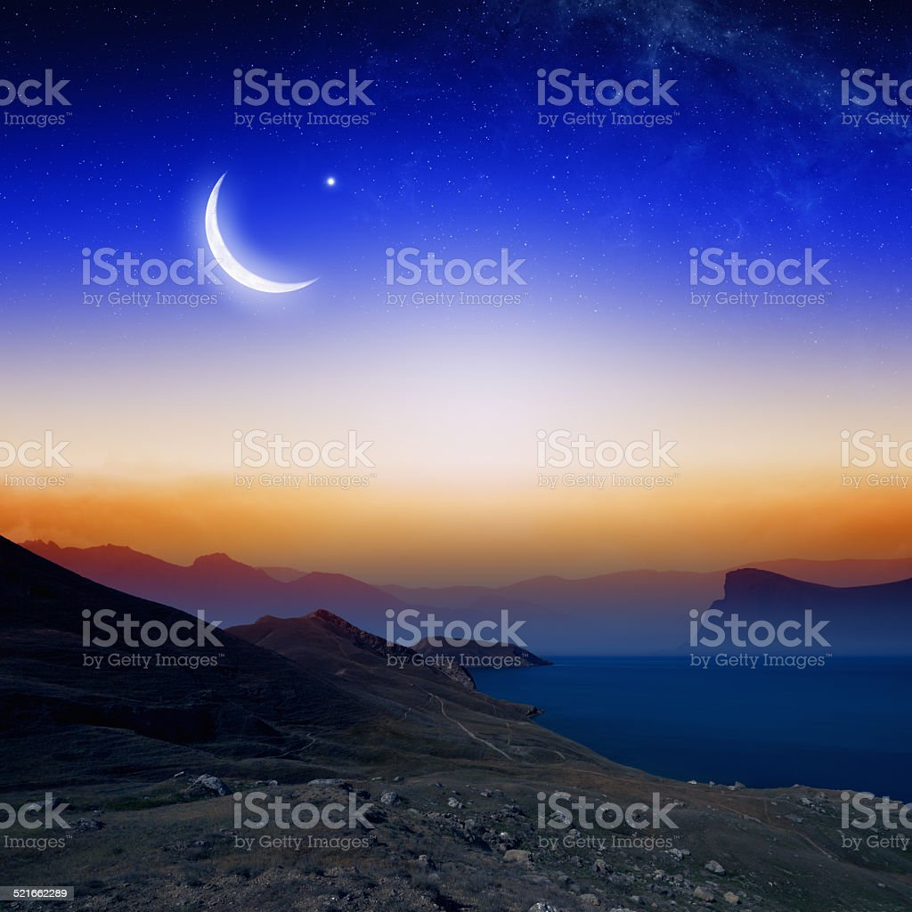 Moon, stars and moutains stock photo
