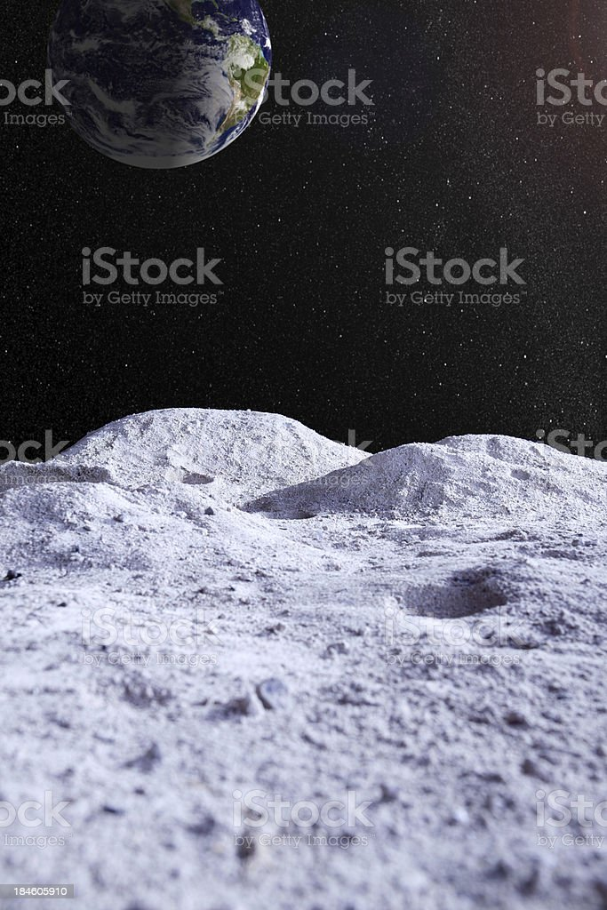 Moon surface with distant Earth and starfield royalty-free stock photo
