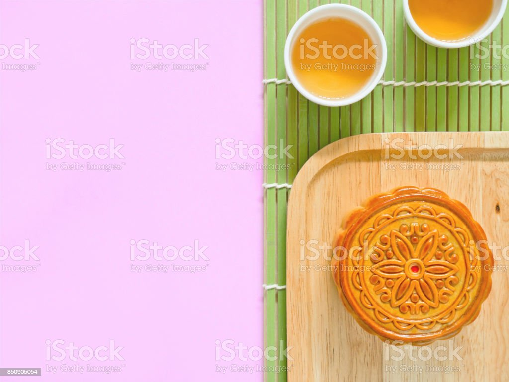 Mooncake on a wooden plate for Mid-Autumn Festival stock photo