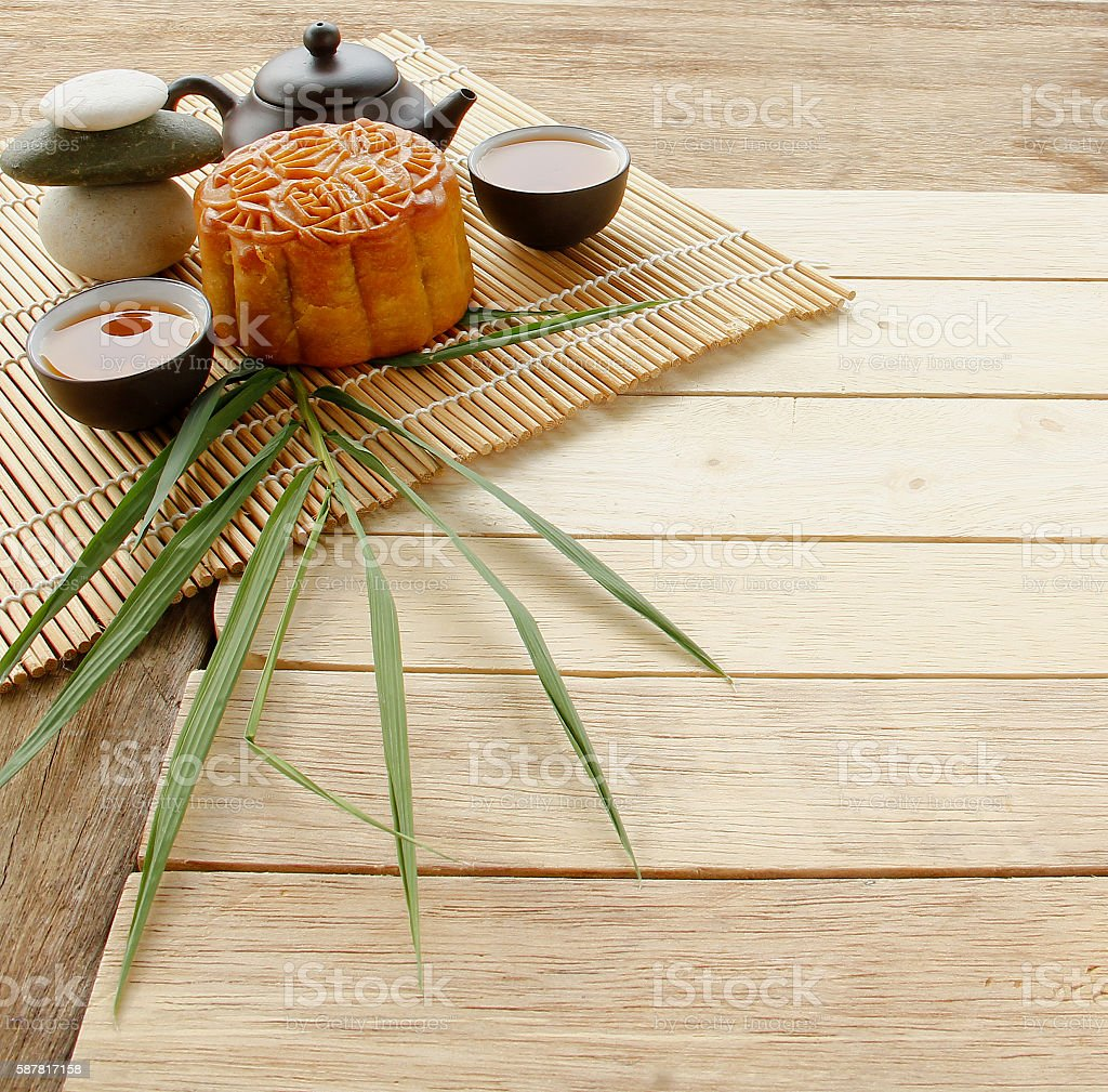 Mooncake on Wooden Background. stock photo