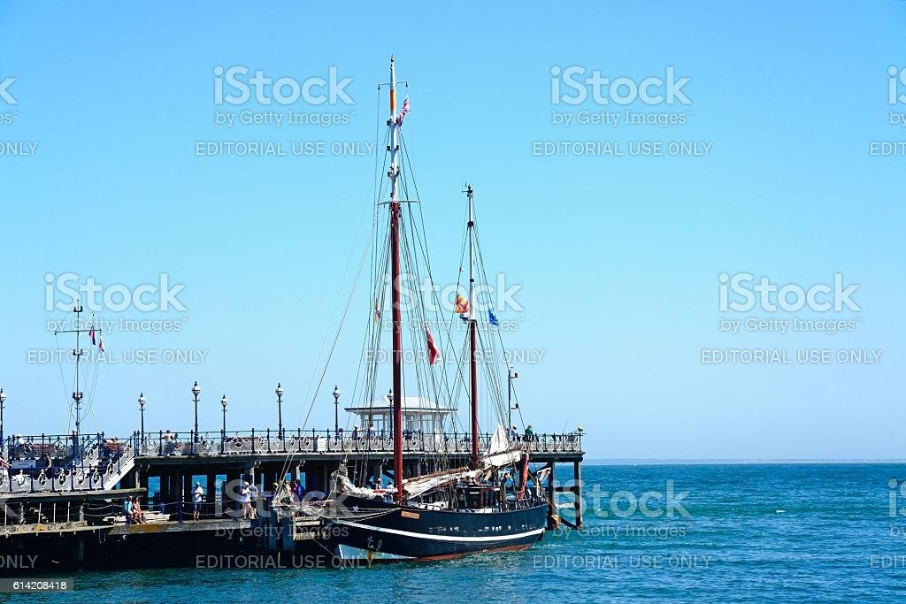 Moonfleet tallship moored along pier, Swanage. stock photo
