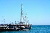 Moonfleet tallship moored along pier, Swanage.