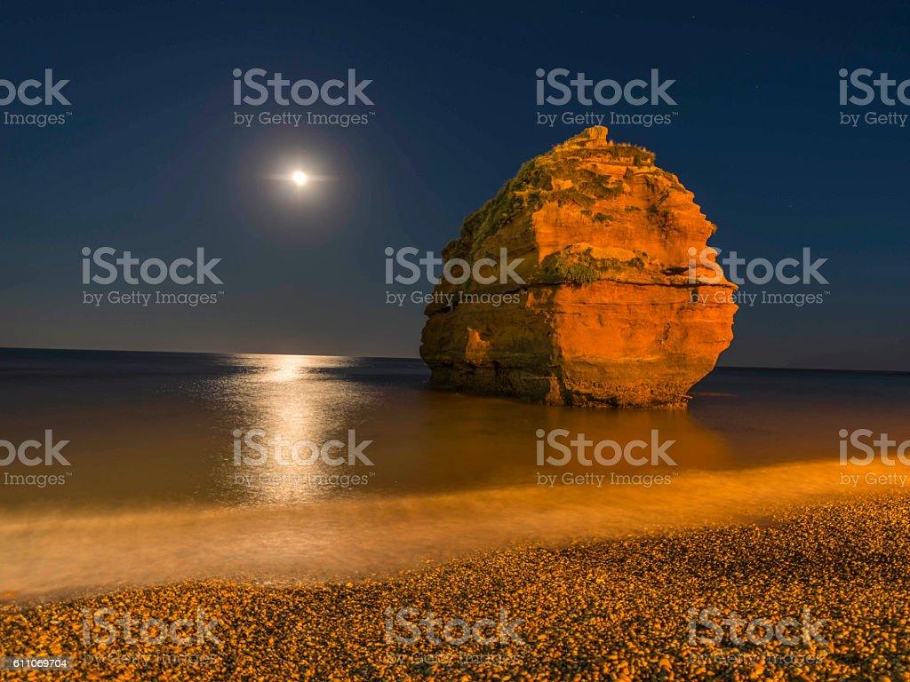 Moonlight at Ladram Bay Cove, Devon stock photo